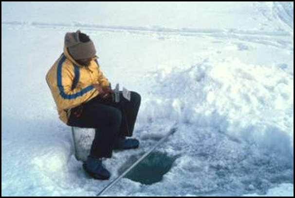 John Goodman fishing on the ice in Greely Fiord